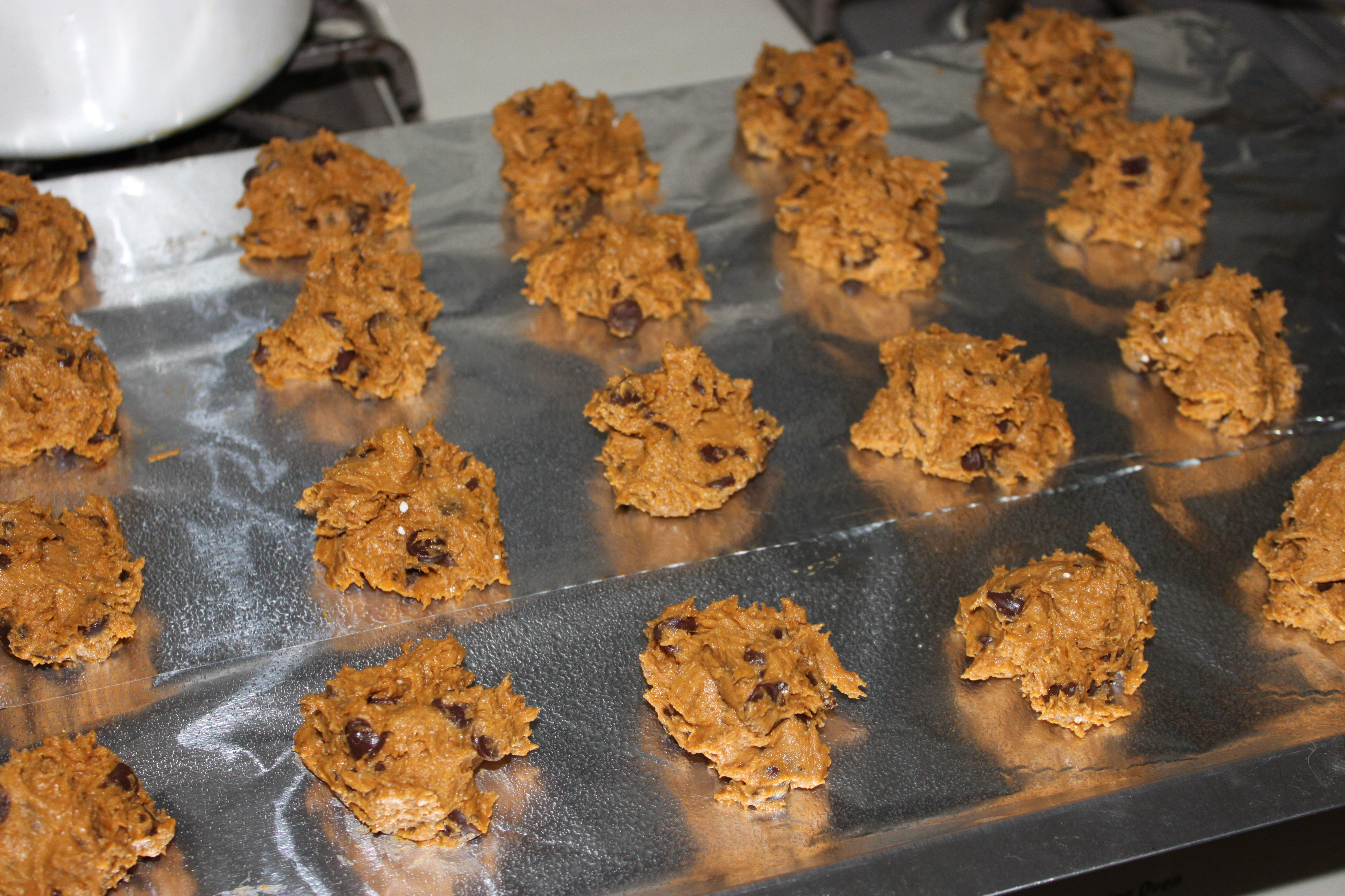 the cookie sheet onto the counter a few times to keep your cookies ...